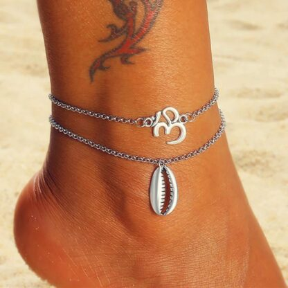 2 részes ezüst színű bokalánc - kagylós és om medállal