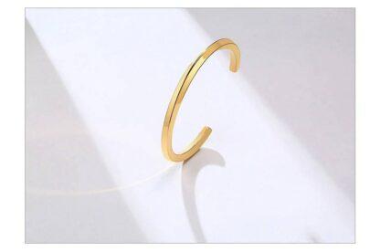 Csavart nemesacél karperec - 4mm vastag - arany színben_kk113