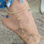 Nemesacél arany színű karkötő - szív, kagyló és csillag medálokkal