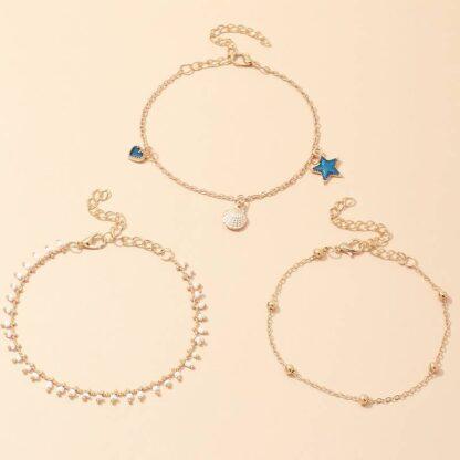 Nemesacél arany színű karkötő - szív, kagyló és csillag medálokkal 2